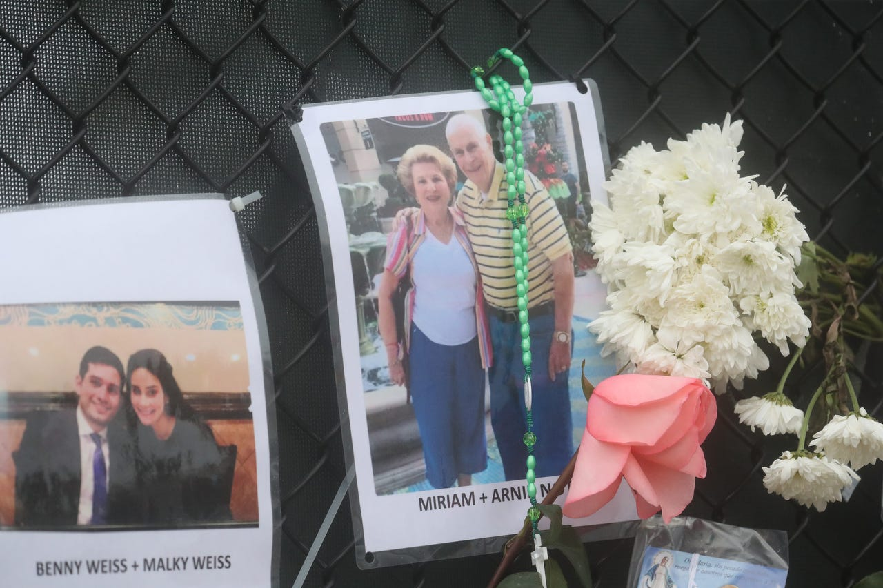 Shown are Myriam Caspi Notkin (possibly Miriam Notkin) and Arnie Notkin. Posters of some of the people missing from the Champlain Towers south condo collapse in Surfside, Florida, were photographed on Monday, June 28, 2021 at the memorial fence near the scene.