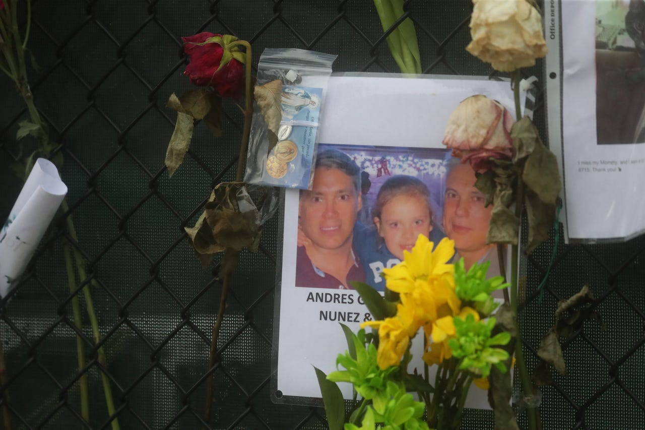 Believed to be shown are Andres Galfrascoli, Fabian Nunez and Sofia Nunez. Posters of some of the people missing from Champlain Towers south condo collapse in Surfside, Florida, were photographed June 28, 2021, at the memorial fence near the scene.