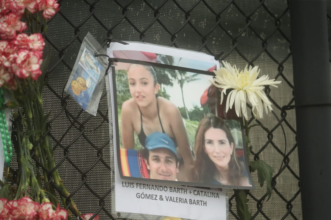 Shown is Luis Fernando Barth, Catalina Gomez and Valeria Barth. Posters of some of the people missing from the Champlain Towers south condo collapse in Surfside, Florida, were photographed on Monday, June 28, 2021 at the memorial fence near the scene.