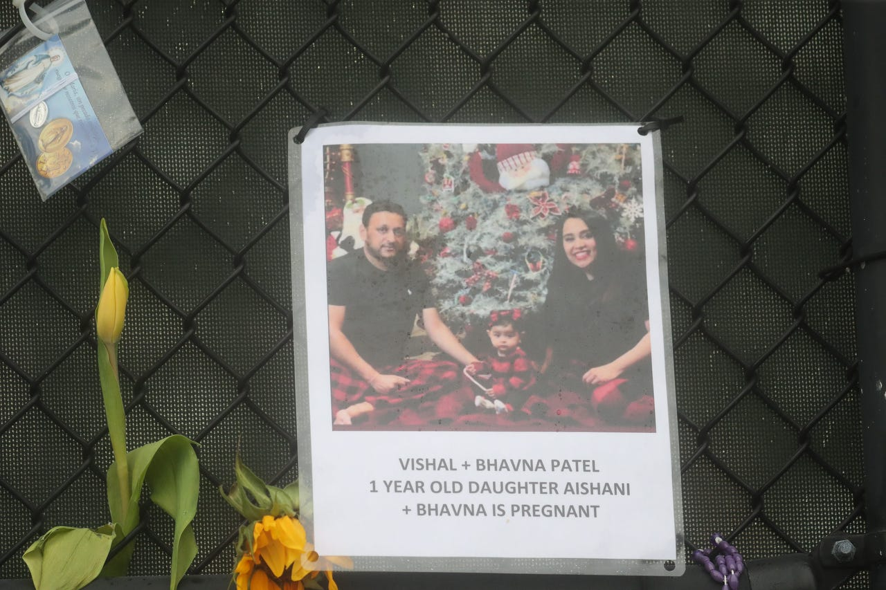 Shown are Vishal Patel, Bhavna Patel and their 1-year-old daughter, Aishani Patel. The poster also says Bhavna Patel was pregnant. Posters of some of the people missing from the Champlain Towers south condo collapse in Surfside, Florida, were photographed June 28, 2021 at the memorial fence.