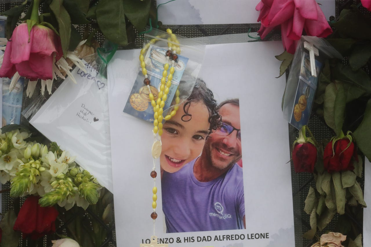 Shown are Lorenzo Leone and his father, Alfredo Leone. Posters of some of the people missing from the Champlain Towers south condo collapse in Surfside, Florida, were photographed on Monday, June 28, 2021 at the memorial fence near the scene.