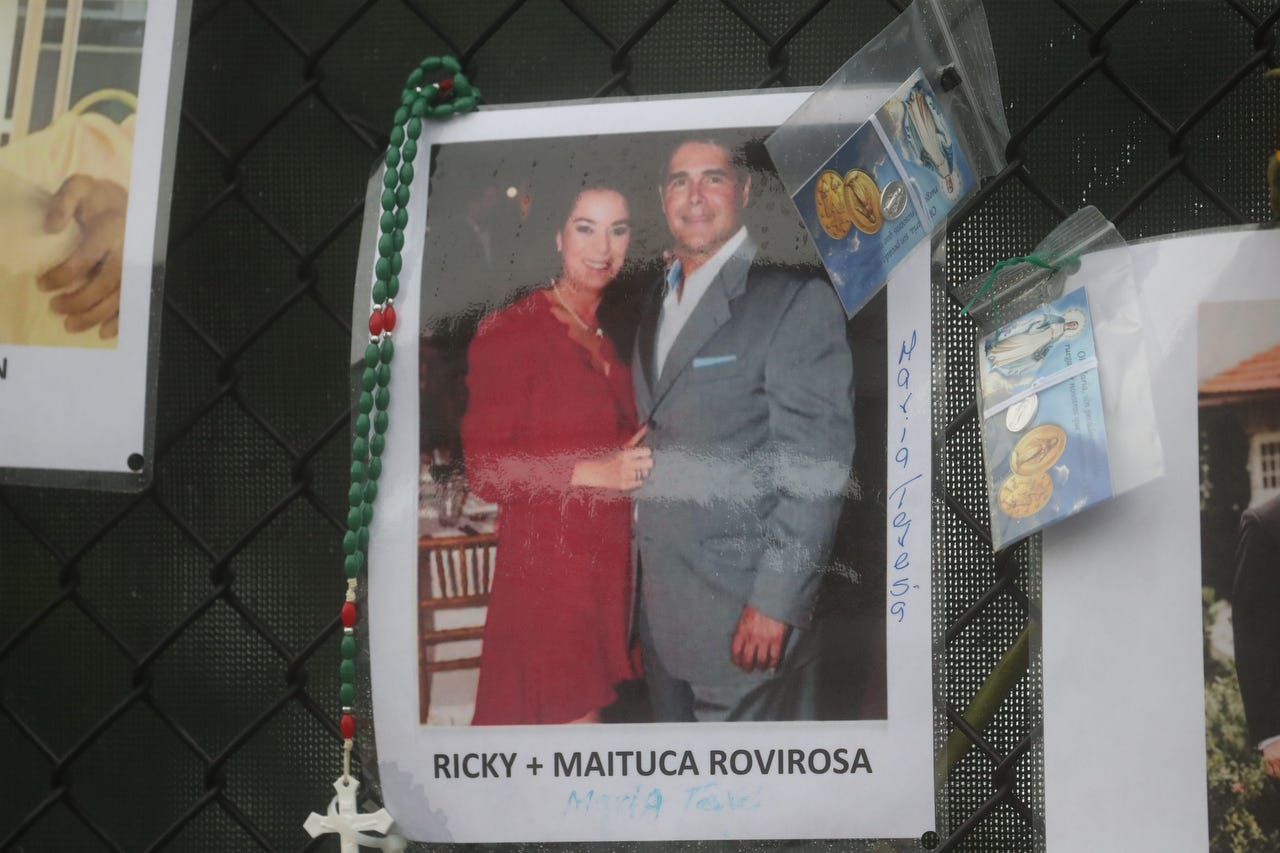 Shown are Ricky Rovirosa (aka Richard George Rovirosa or Richard Rovirosa) and Maituca Rovirosa (or possibly Maria Rovirosa). Posters of some of the people missing from the Champlain Towers south condo collapse in Surfside, Florida, were photographed on Monday, June 28, 2021 at the memorial fence near the scene.