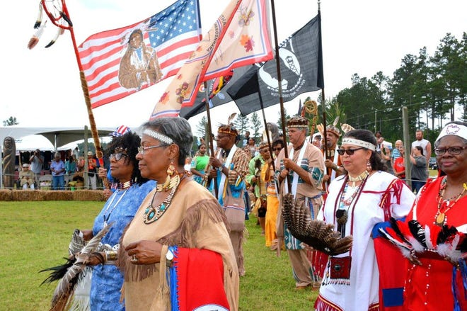 Cheroenhaka [Nottoway] Indian Tribe Color Guard leads dancers into the circle during the Grand Entry at the 'Green Corn Dance' Powwow held at Cattashowrock Town in Courtland, Va. in 2018.