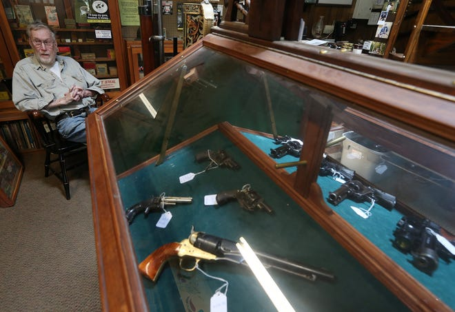 """Sandy Kane, owner of Kane's Gun Shop in North Kingstown, said business is still robust, due to """"all the uncertainty in 2020 and 2021."""""""
