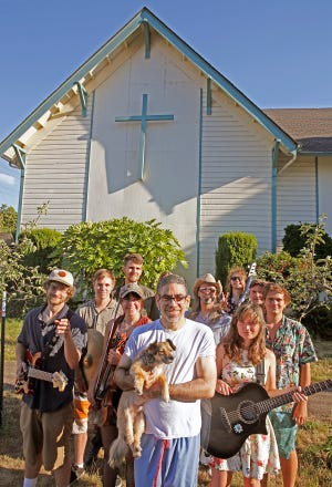 Paster Eli Varedas, center, has recruited an eclectic group of musicians while hosting gatherings at the Alluvium church in Eugene.