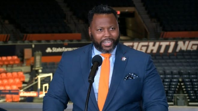 State Rep. Kambium Buckner, D-Chicago, speaks at a news conference at the University of Illinois Tuesday, June 29, 2021, at which the governor signed his bill allowing college athletes to be paid for the use of their name and likeness.