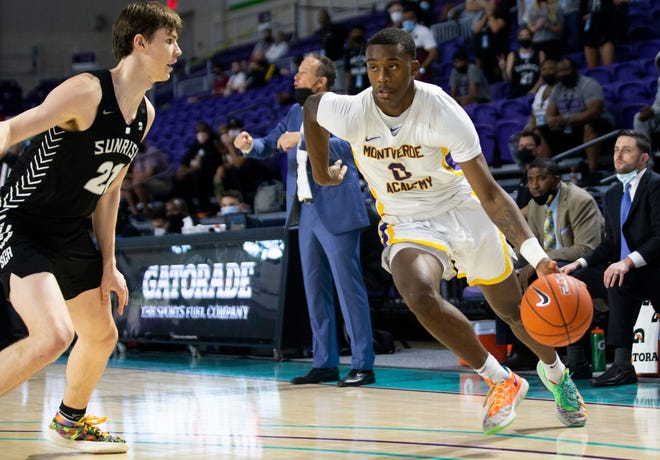 Montverde's Academy (Fla.) forward Dariq Whitehead, right, drives toward the basket during the GEICO Nationals Tournament boys championship game on April 3 in Fort Myers, Florida. Whitehead a top 10 national prospect took a recruiting visit to Kansas this week.