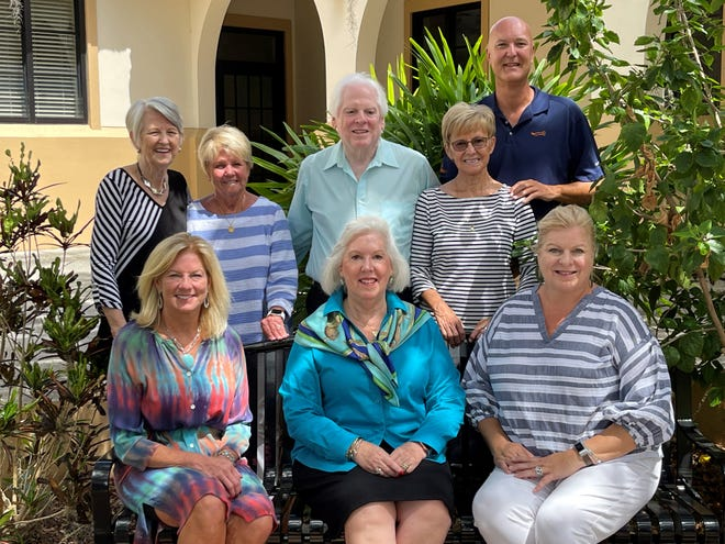 The Karin's Causes team includes, back row, Nola Hietbrink, Donna Hardin, Tom Stanley, Karin Gustafson, and Shane Hietbrink. Seated are Laura McCann of the Animal Rescue Coalition, MaryAnne Young of the New College Foundation, and Ashley Brown of the Women's Resource Center.