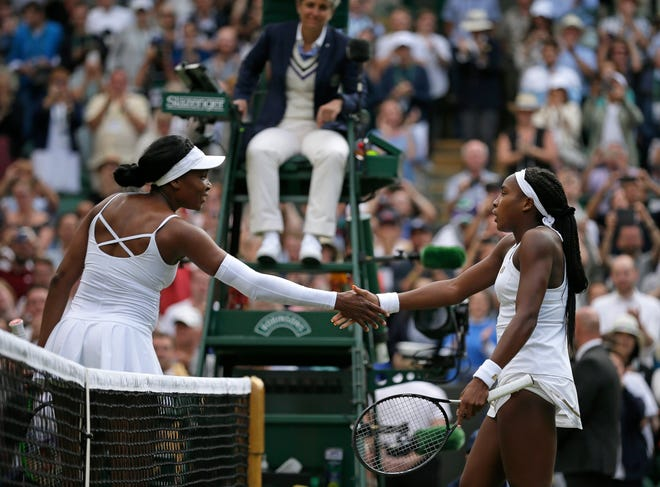 """Cori """"Coco"""" Gauff, right, greets the Venus Williams at the net after winning their women's singles match during day one of the Wimbledon Tennis Championships in London on July 1, 2019."""