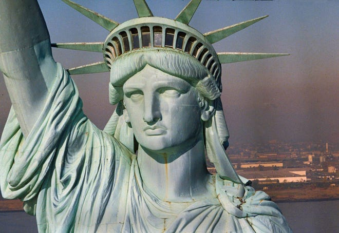 The newly renovated Statue of Liberty is seen July 3, 1986, in New York Harbor.