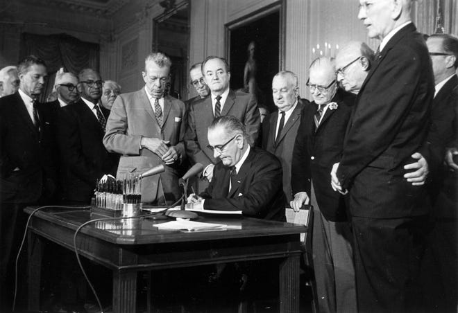 This July 2, 1964 photo shows President Lyndon Baines Johnson signing the Civil Rights Act in the East Room of the White House. Standing, from left, are Sen. Everett Dirksen, R-Ill.; Rep. Clarence Brown, R-Ohio; Sen. Hubert Humphrey, D-Minn.; Rep. Charles Halleck, R-Ind.; Rep. William McCullough, R-Ohio; and Rep. Emanuel Celler, D-N.Y. The Civil Rights Act of 1964 is considered one of the most celebrated legislative achievements in U.S. history. This law made it illegal to discriminate on the basis of race, color, religion, sex, or national origin and barred unequal application of voter registration requirements.