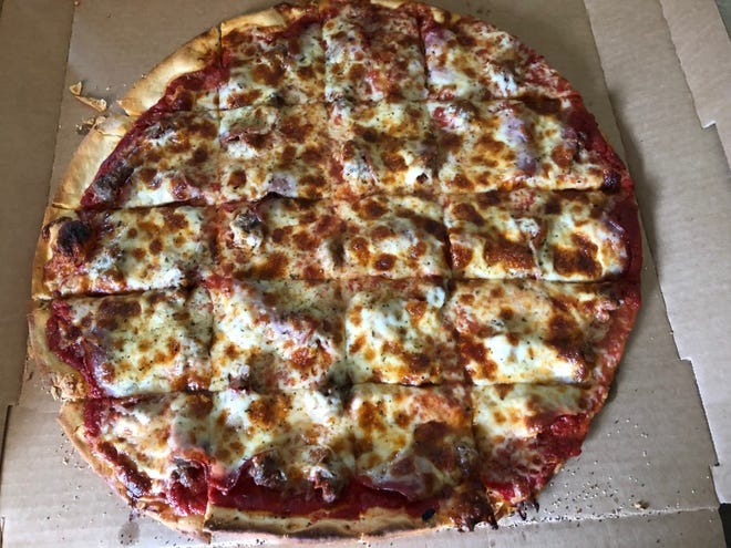The thin-crust pizza with Italian sausage and Canadian bacon from Rosati's Chicago Pizza.