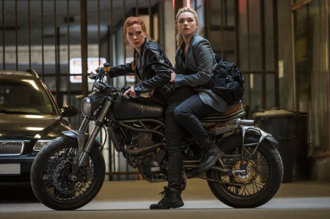 """This image released by Marvel Studios shows Scarlett Johansson, left, and Florence Pugh in a scene from """"Black Widow."""" (Jay Maidment/Marvel Studios-Disney via AP)"""