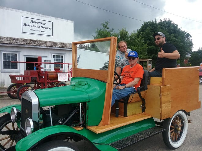 """Bill Scott gave rides all day on a 1925 Ford Model T truck. Scott donated the truck to the Wethersfield FFA and coached the restoration. It is painted Wethersfield green"""""""