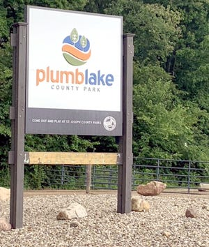 The bottom portion of the sign at Plumb Lake Park is being repaired after it was vandalized. An increase in vandalism at county parks has prompted enhanced security measures.