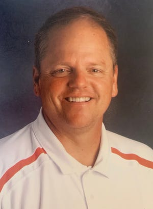 New Hanover's Keith Moore is retiring Wednesday after serving as the school's athletic director for 20 years.