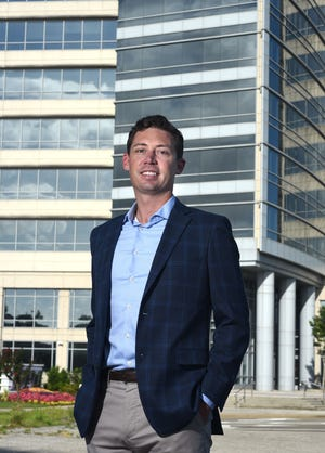 Elliott Miller, Vice President of Finance at PPD, stands in front of the PPD office in downtown Wilmington, N.C., Tuesday, June 29, 2021.  Miller is one of the StarNews 40 Under 40 honorees for 2021.
