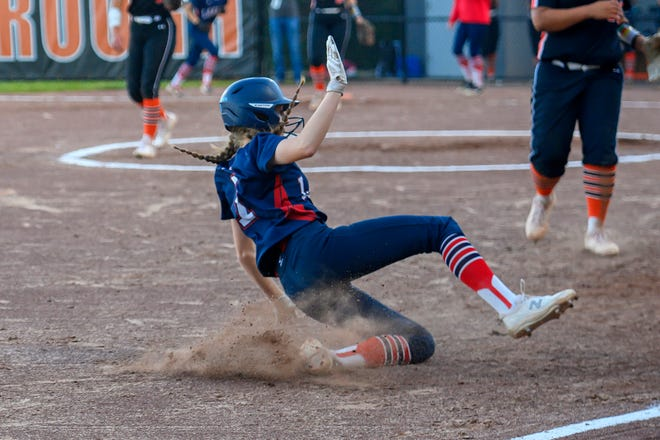 Apponequet's Lauren Bernaiche slides into third base