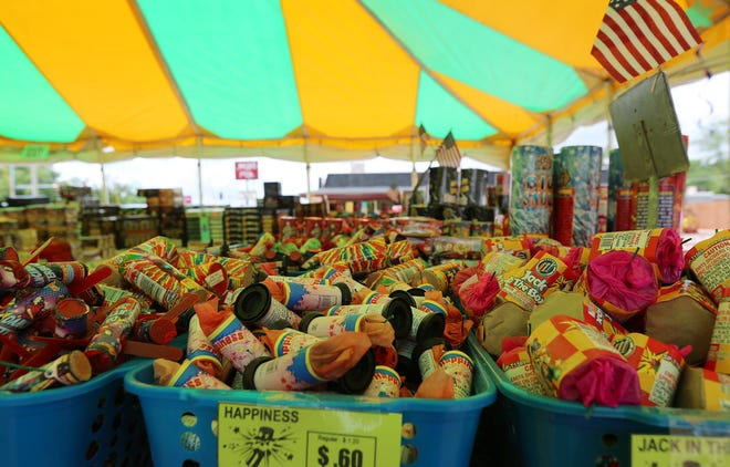 Baskets overflowing with fireworks at Kaboomers tent in Mazzio's Pizza parking lot.