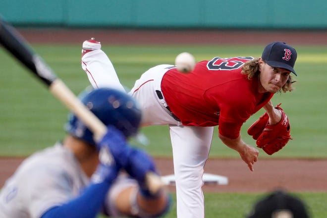 Boston Red Sox starting pitcher Garrett Richards (43) throws to a Kansas City Royals batter during the Red Sox's 6-5 win at Fenway Park.