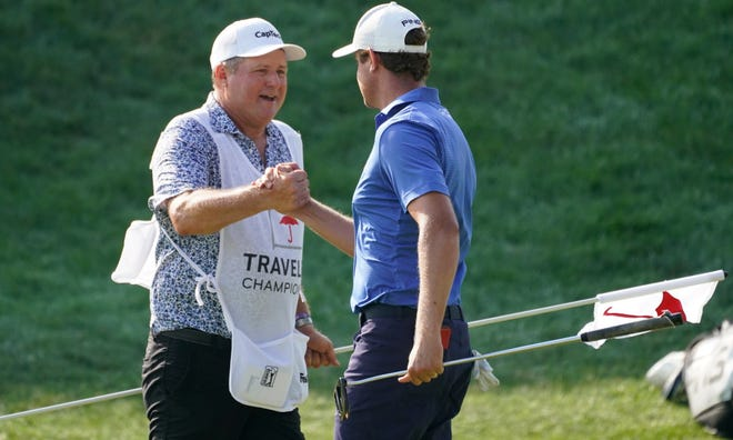 Harris English, right, celebrates a birdie on the 18th green with his caddie Eric Larson during the final round of the Travelers Championship in Cromwell.
