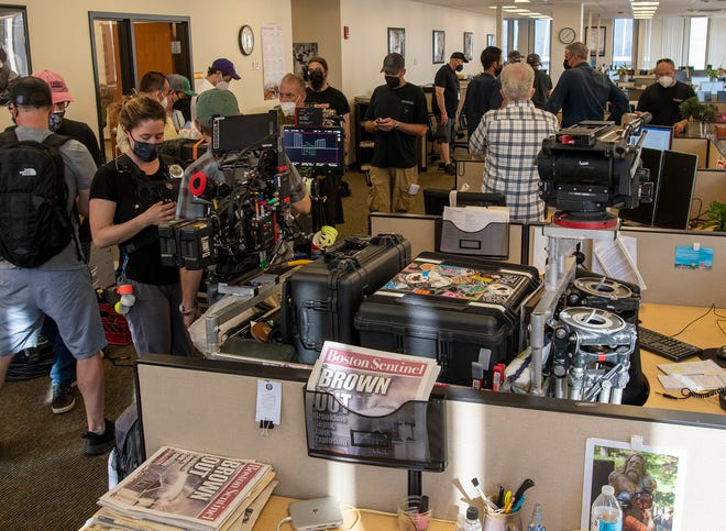 """A scene from the movie """"Confess, Fletch"""" was shot in the newsroom of the Telegram & Gazette on Tuesday."""
