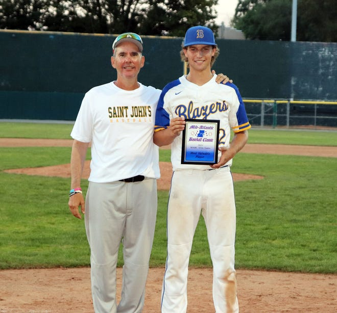 Clear Spring's Eric Bender, right, poses for a photo with National all-star team coach Omar Enriquez after being named MVP of the Mid-Atlantic Baseball Classic's Elite Game on Monday at Municipal Stadium.