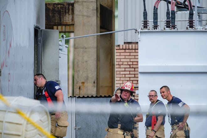 Dover firefighters Anthony Miceli, Capt. Michael Mossor, Kent Thompson and Ryan Parrish (left to right) were among those who responded to an external diesel generator fire at the Dover Light & Power on Tuesday afternoon. TIMES-REPORTER/ANDREW DOLPH
