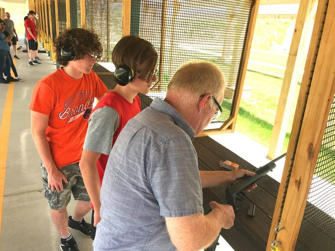 Brothers Joe (left) and Sam Moose of Delaware watch as their grandfather, Bob Mapes of Westerville, loads a rifle at the Delaware Wildlife Area Shooting Range, operated by the Ohio Department of Natural Resources on state Route 229, on the Delaware Wildlife Area. The range sits next to the site of a smaller range that was closed in 2017.