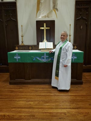 Pastor Cheryl Rondeau-Bassett stands at the alter in Watertown's Grace Lutheran Church