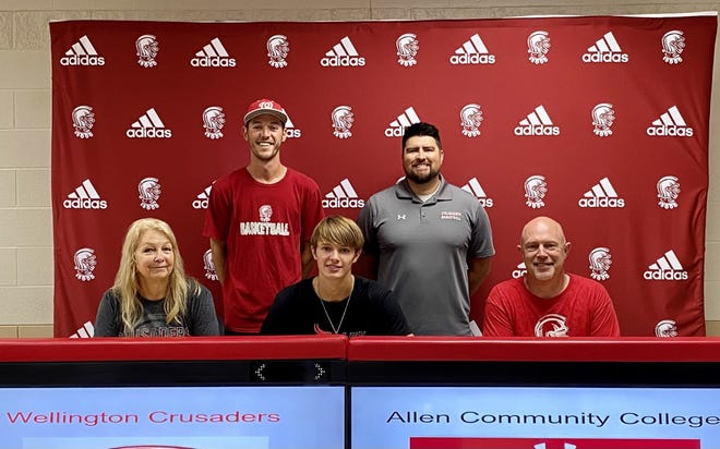 Tanner Meyer (center) surrounded with family and coaches from left to right: Tiff Meyer, Coach Wiley, Coach Newman and Bob Meyer