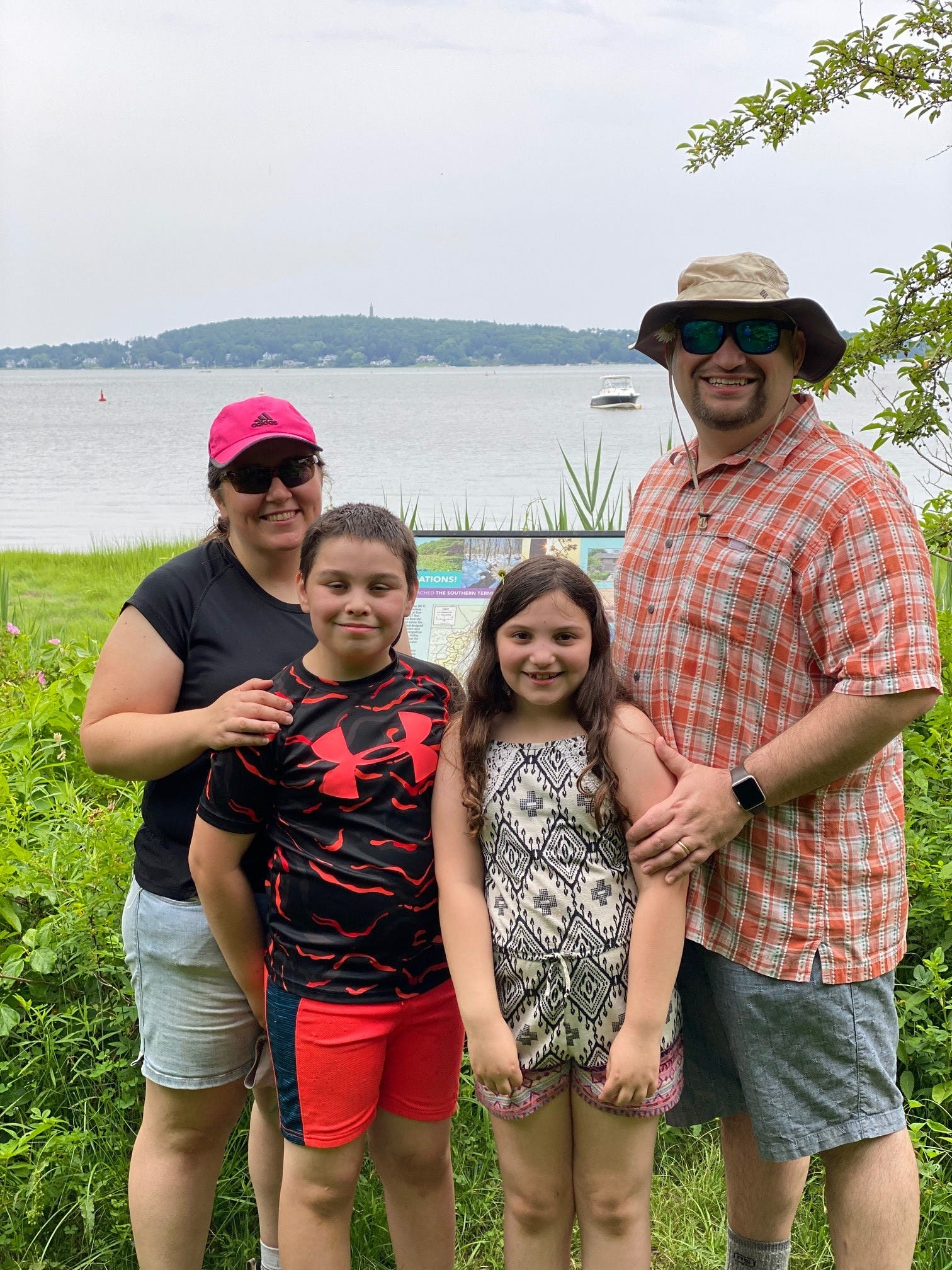 The Kaiserman family, from left, Meghan, Nathan, Emily and Ryan, pose for a family photo after completing the Bay Circuit Trail in 2020.