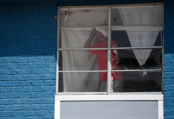 A man looks for bullet holes in his apartment, Tuesday, June 29, 2021, in Flour Bluff. The Corpus Christi Police Department had two officer-involved shootings this week: One was in the 900 block of Quetzal Street and the other was at the 3800 block of Caravelle Parkway.