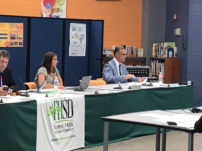 Forest Hills Superintendent Scot Prebles, right, said critical race theory would not intentionally be allowed into teachings for students or training for staff at Monday's board meeting.