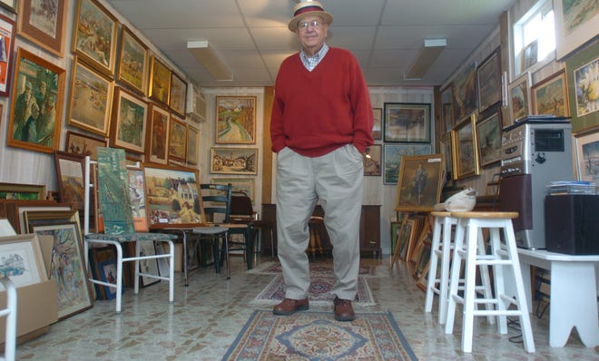 """Lewis """"Pooch"""" Blackson stands in his Galley in the Alley while wearing his famous straw hat in this 2013 Tribune file photo. He would often invite people into the garage behind his home to view his collection of artwork, albums and other memorabilia."""