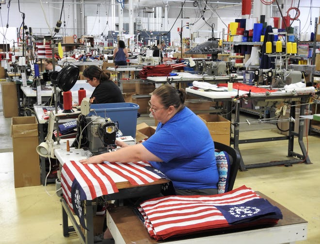 Jonna Smith sews yacht flags, a specialty flag made by Annin Flagmakers of Coshocton. The Coshocton, Ohio plant produces U.S. flags, state flags, and specialty flags. Annin has others factories in Virginia.
