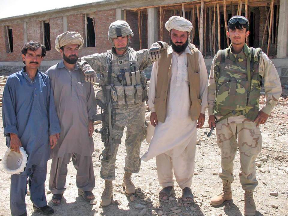 Zalmay Niazy, right, during his time as a translator with the U.S. military in Afghanistan. Until Afghan translators forged trust with their commanders, they often worked without a weapon.