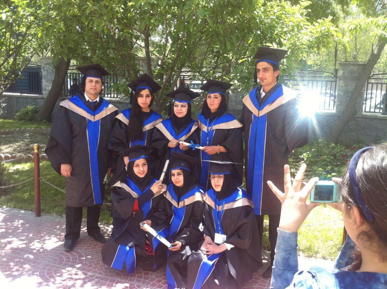 Zalmay Niazy, right, after graduating from Kardan University in Kabul, Afghanistan.