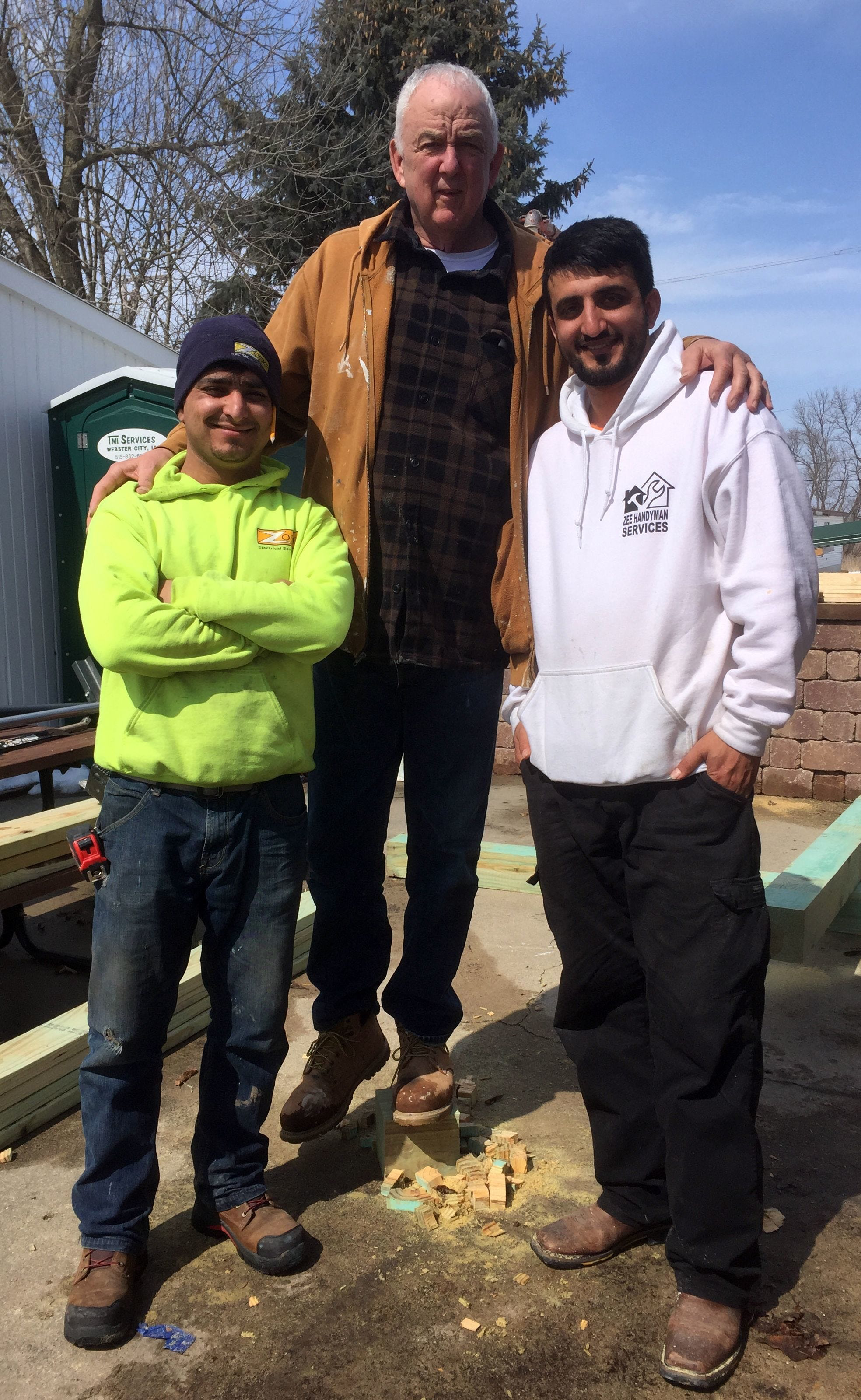 Cousins Farid Ahmad, left, and Zalmay Niazy, right, are shown above with their friend Mike Ingebritson.