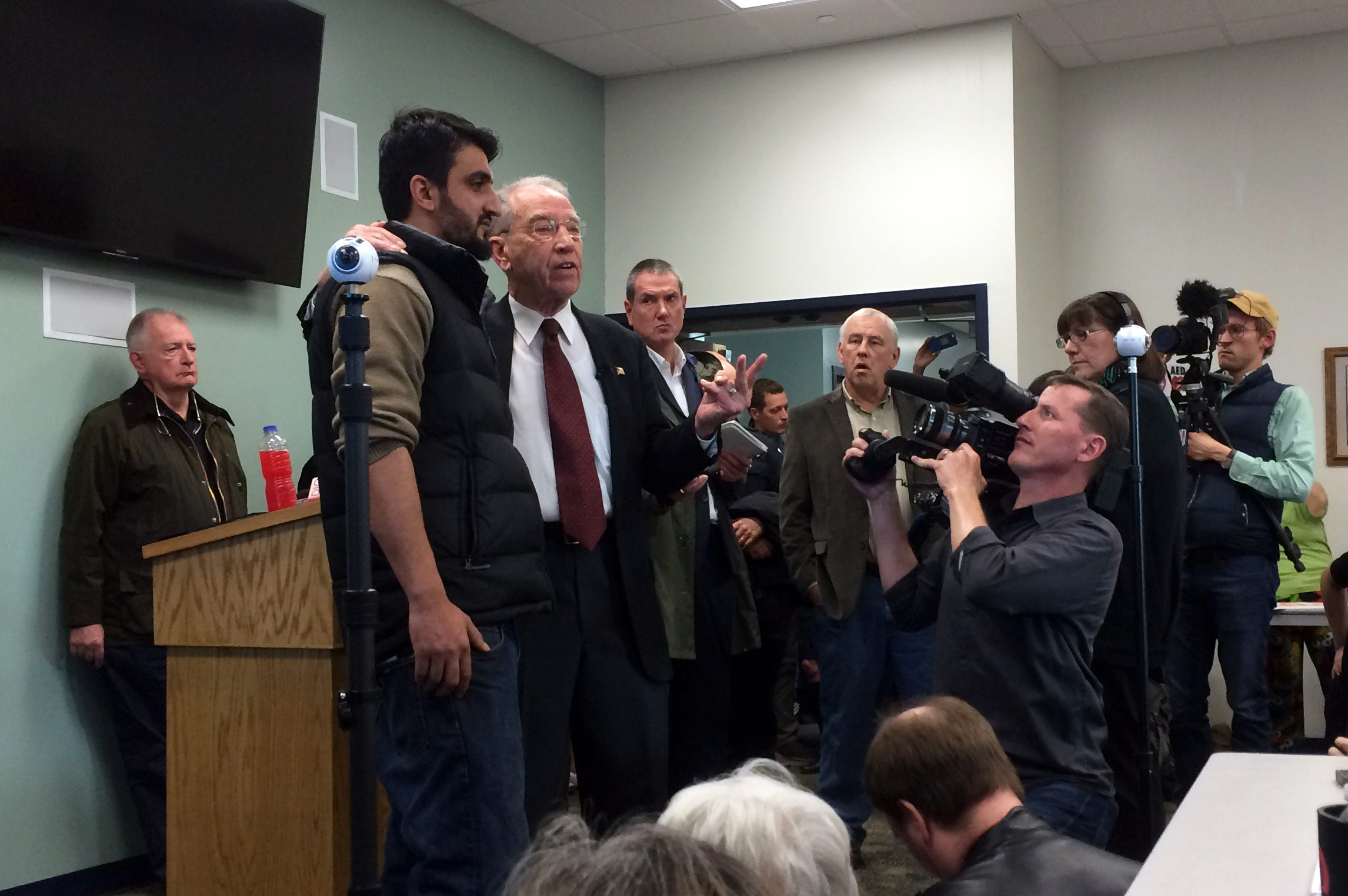 Zalmay Niazy, left, had a chance meeting with U.S. Sen. Chuck Grassley at an Iowa Falls town hall meeting in 2017. When the Iowa Falls Times Citizen reached out to Grassley in 2021 about Niazy's asylum case, a spokesperson said Ethics Committee rules prohibited him from intervening.