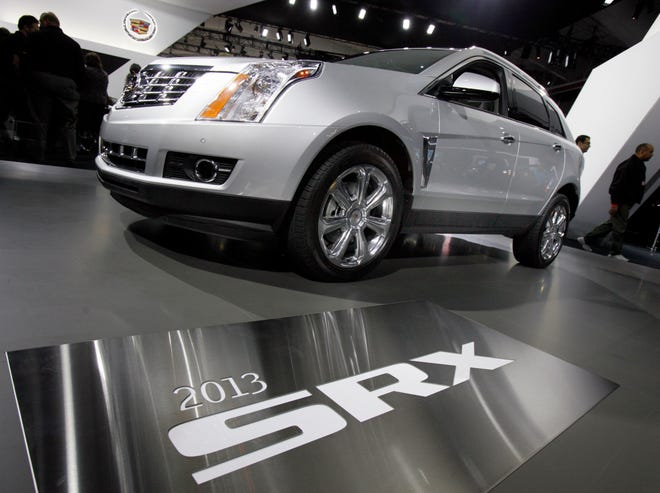 This April 5, 2012 file photo shows the 2013 Cadillac SRX displayed at the New York International Auto Show, in New York's Javits Center. General Motors is recalling more than 380,000 older SUVs in the U.S., Tuesday, June 29, 2021, many for a second time, to fix a suspension problem that can cause them to sway at highway speeds. The recall covers 2010 through 2016 Cadillac SRX and 2011 and 2012 Saab 9-4X SUVs.
