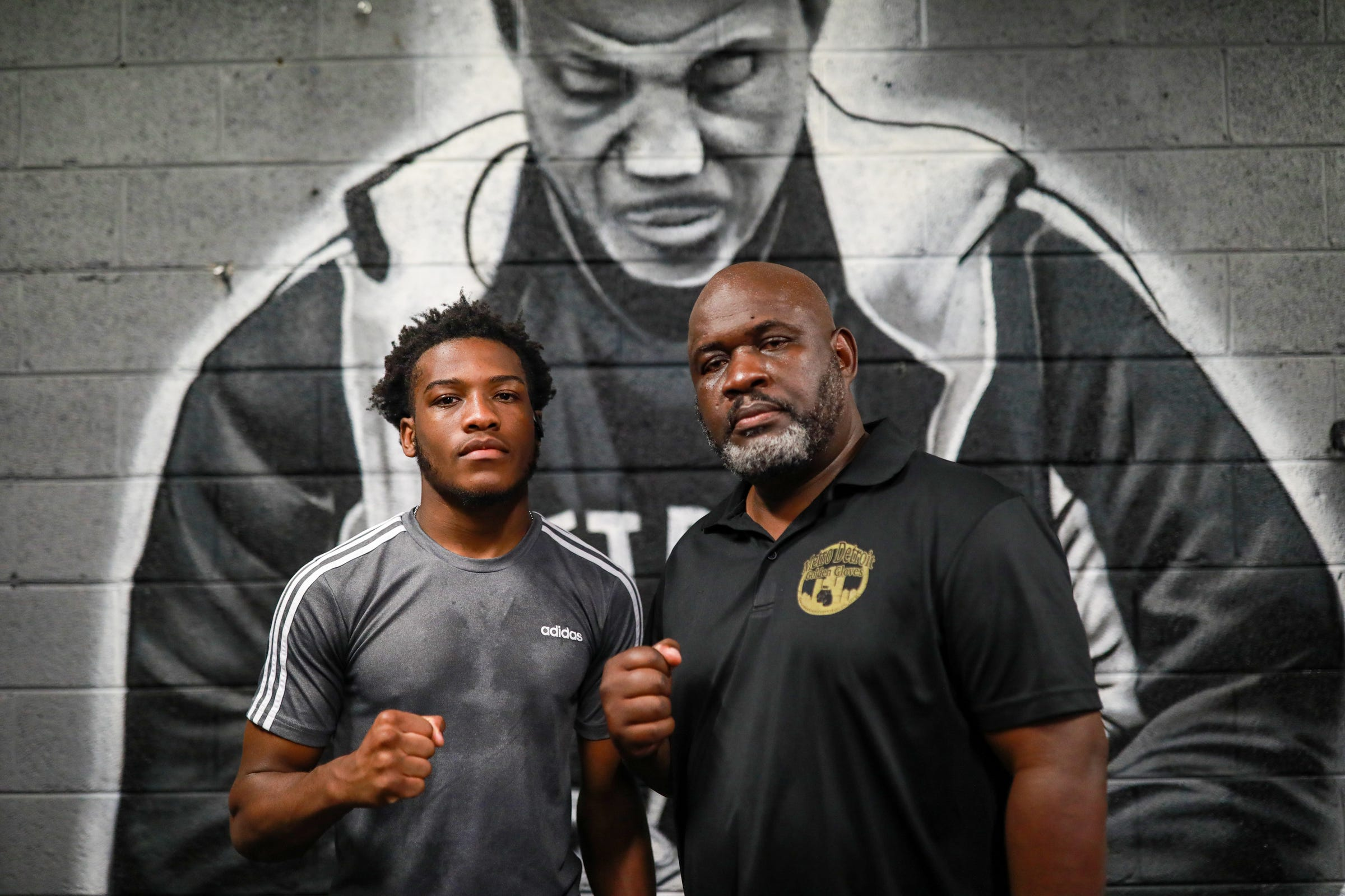 Ansel Stewart poses for a photo with boxer Lance Smith at the SuperBad Boxing Gym in Detroit  on Saturday, June 5, 2021, where boxers spar in preparation for the 2021 Metro Detroit Golden Gloves tournament. Jamaican-born Stewart, a superintendent for the City of Detroit's Department of Transportation (DDOT), has spent most of his adult years helping Detroit youth and young adults through the sport of boxing. His journey of giving back began as a volunteer boxing official and now he runs the Metro Detroit Golden Gloves, a nonprofit which puts on an annual amateur tournament in Detroit that will take place in July.
