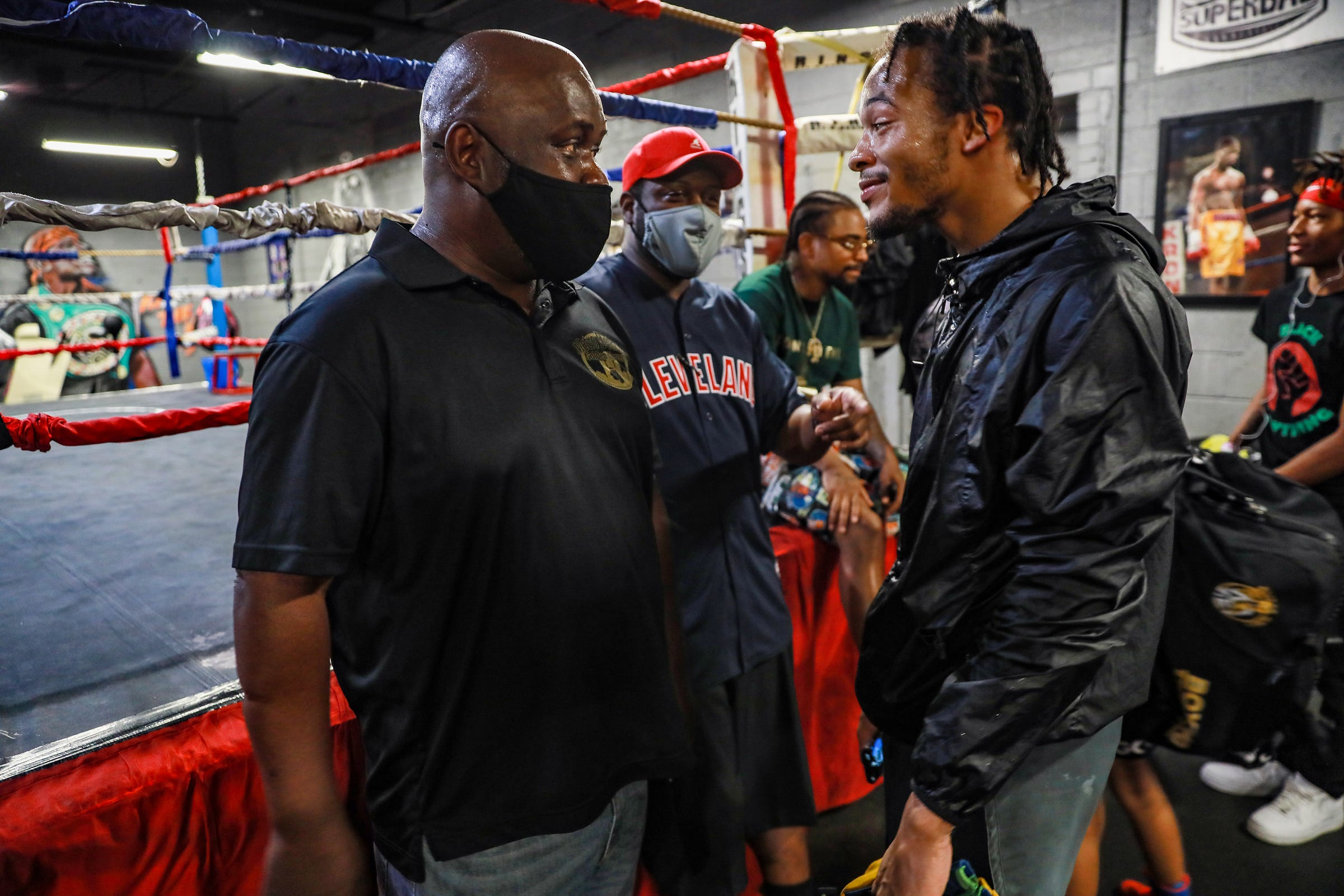 Ansel Stewart, left, chops it up with professional boxer Gordie Russ II on Saturday, June 5, 2021, before sparring begins in preparation for the Metro Detroit Golden Gloves tournament begins at the SuperBad Boxing Gym in Detroit.