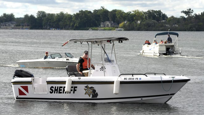 In this file photo an Oakland County Sheriff's Marine Division member patrols Cass Lake.