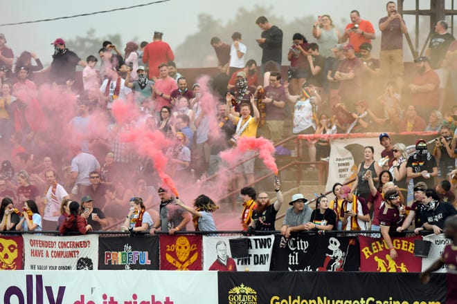 Detroit City FC fans set off various colored smoke bombs after the start of last weekend's match against Chattanooga FC at Keyworth Stadium in Hamtramck.