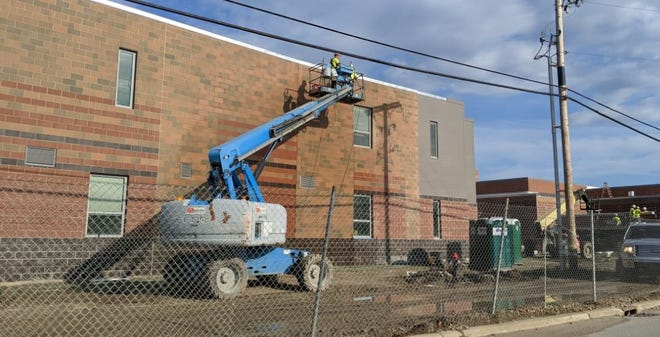 Cosmetic work nears completion at the new Ross High School as district prepares to open the new school in January. A 30-foot walkway will connect the new building to the pool and rest area the district is maintaining.