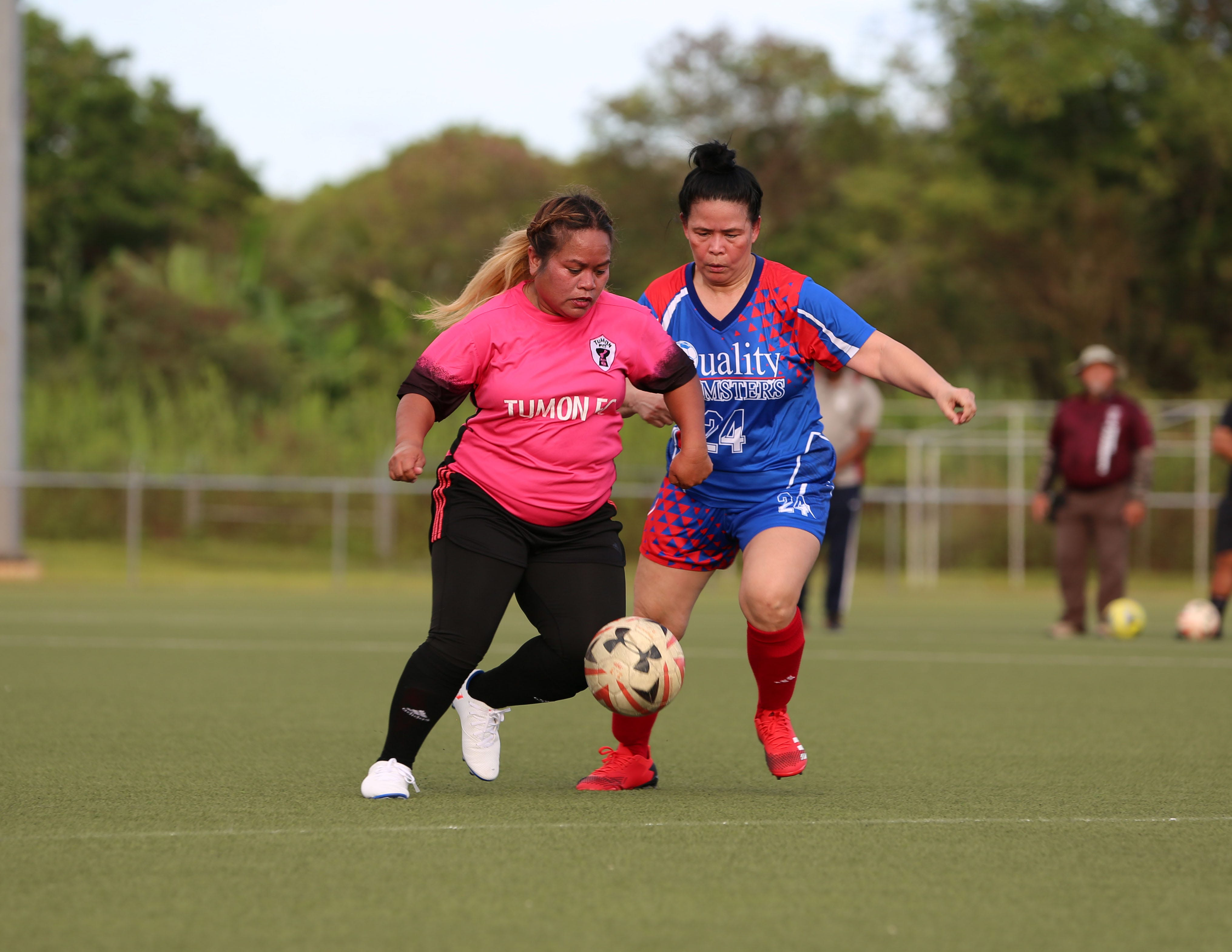 Tumon FC's Resa Saddo attempts to get the ball past Quality Distributors Momsters defender Dee Shippey in an opening day match of the Guam Football Association Women's Recreational League Sunday at the Guam Football Association National Training Center.