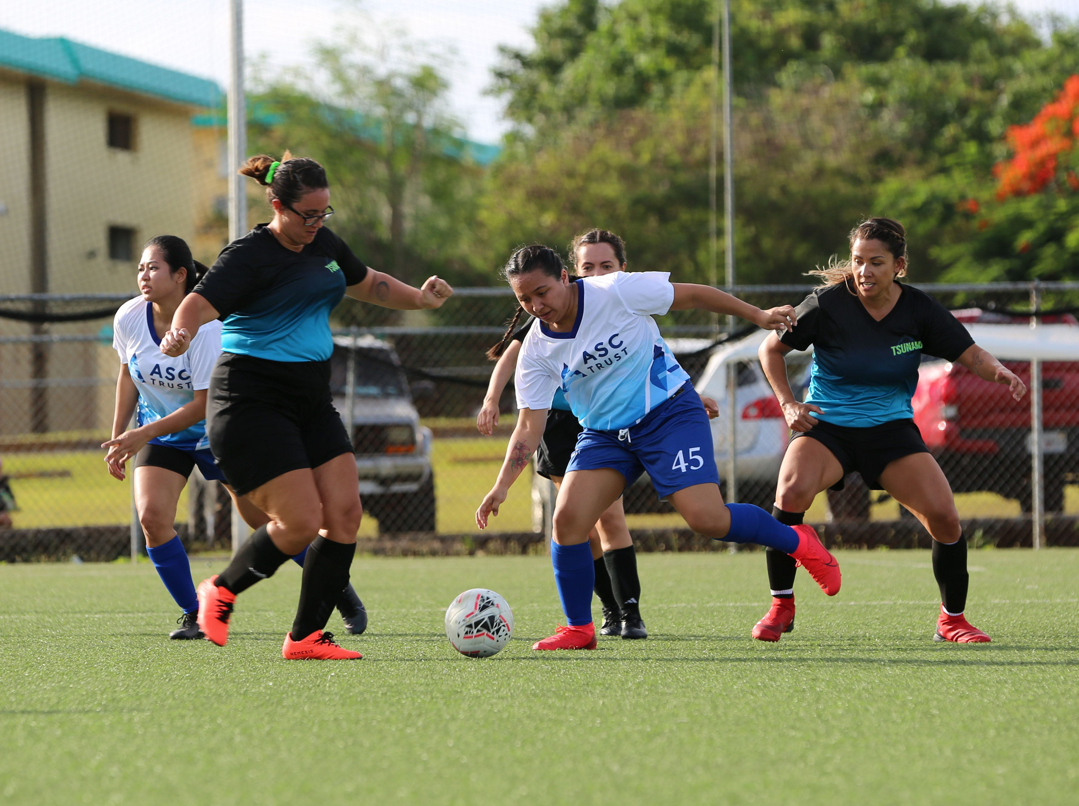 The ASC Kickers and Tsunami play in an opening day match of the Guam Football Association Women's Recreational League Sunday at the Guam Football Association National Training Center.