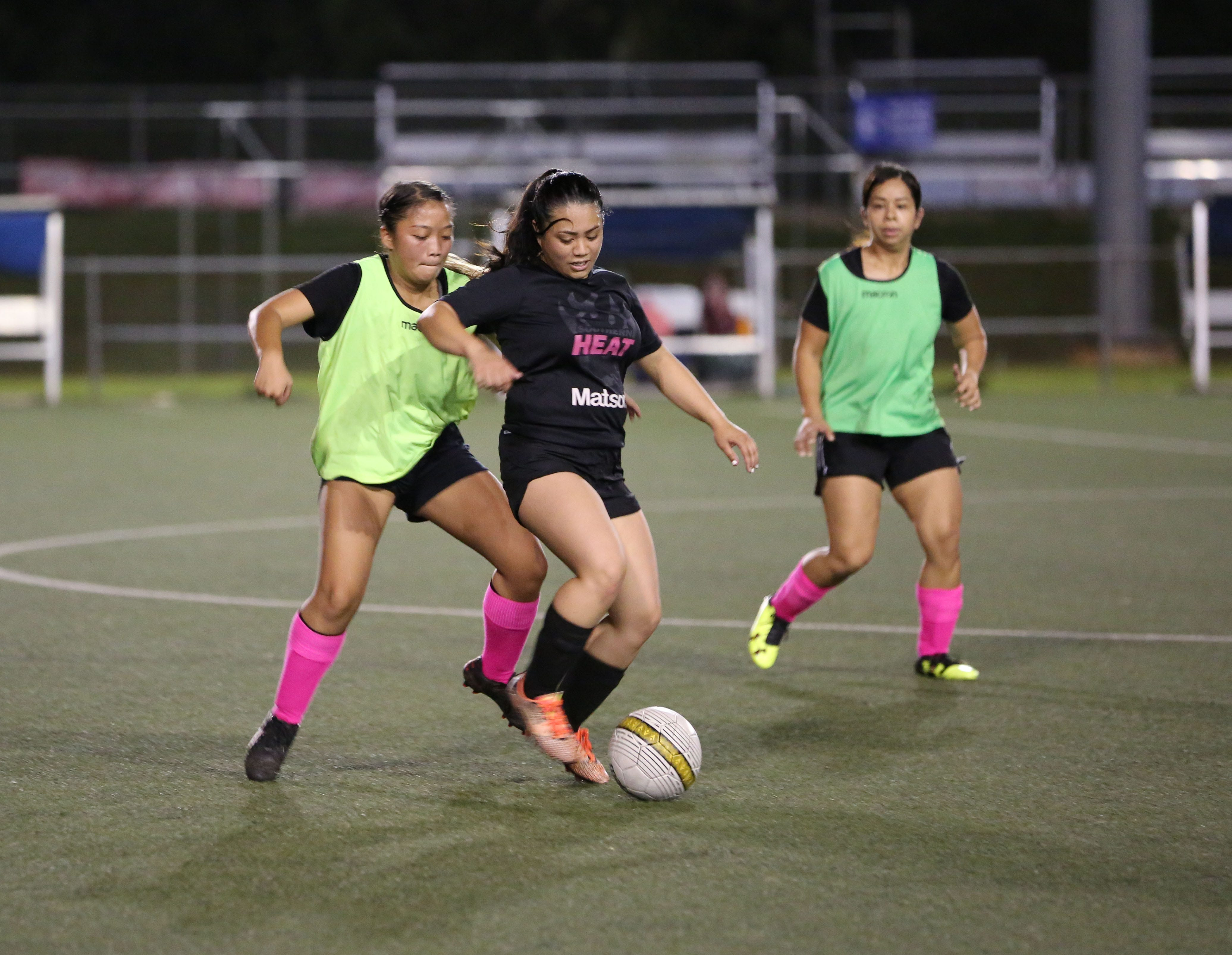 Cars Plus and Southern Heat play in an opening day match of the Guam Football Association Women's Recreational League Sunday at the Guam Football Association National Training Center.