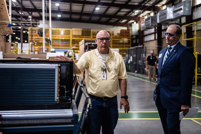 Tyrone Hopper, Manufacturing Engineer Director, points out a Packaged Terminal Air Conditioner (PTAC) during a factory tour at Monogram Refrigeration, LLC on Tuesday, June 29, 2021 in Selmer, Tennessee.